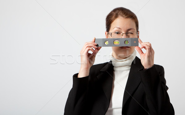 Iş kadını cep seviye bakıyor bir göz Stok fotoğraf © varlyte