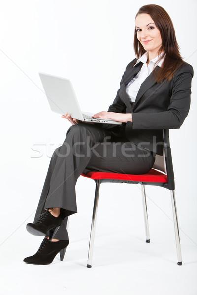 Iş kadını bilgisayar oturma çalışma dizüstü bilgisayar kadın Stok fotoğraf © varlyte