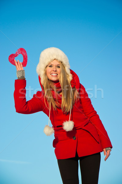 woman in red coat holding heart shape Stock photo © varlyte