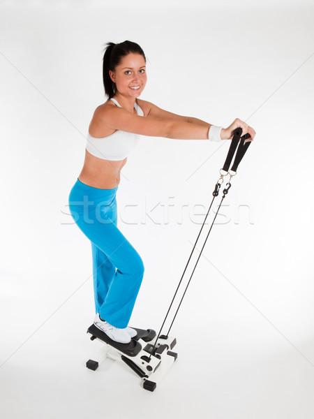 Stok fotoğraf: Kadın · genç · kadın · egzersiz · dikey