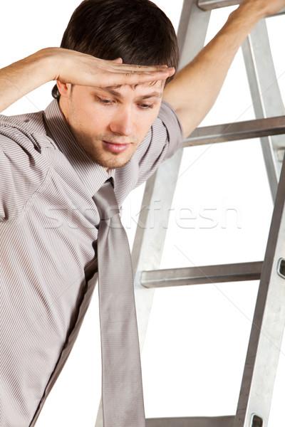 Genç işadamı merdiven aşağı bakıyor yalıtılmış yakışıklı Stok fotoğraf © varlyte