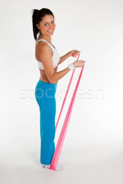 Kadın egzersiz kauçuk şerit genç kadın dikey Stok fotoğraf © varlyte