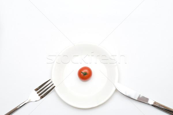 Tomato on the plate Stock photo © varts
