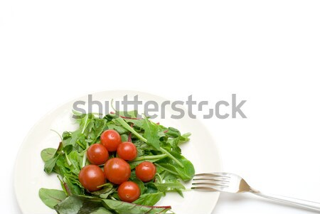 Tomato and leaves Stock photo © varts