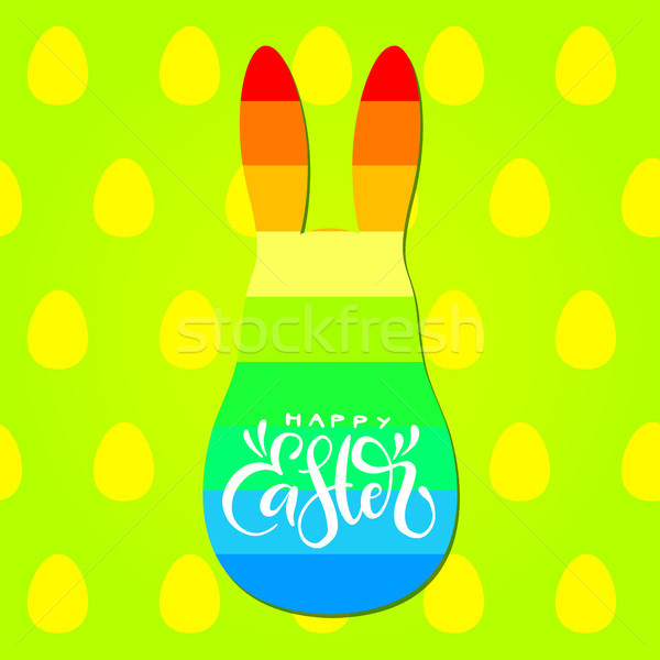Happy Easter calligraphic inscription with rainbow bunny silhouette on green background with eggs pa Stock photo © vasilixa