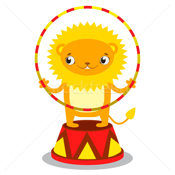 Circus lion on a pedestal with a Hoop in paws. Circus concept. F Stock photo © vasilixa