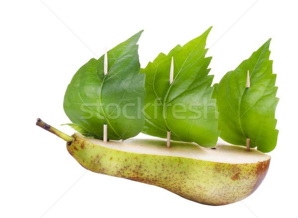 Zöld béke fél körte zöld levelek izolált Stock fotó © vavlt