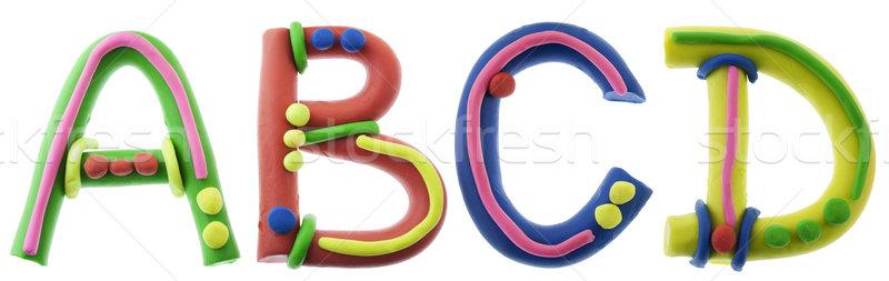 Real cheerful plasticine alphabet Stock photo © vavlt