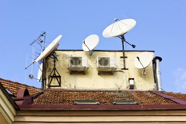 Progresso história sempre azulejos telhado velho Foto stock © vavlt
