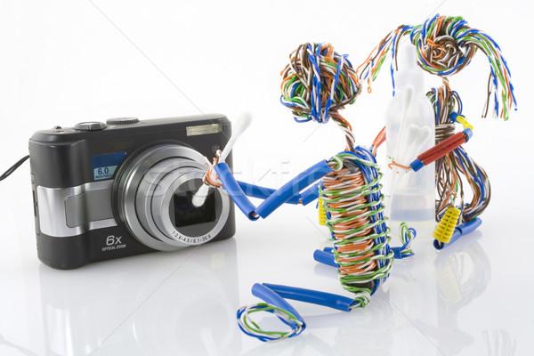 Czyszczenia zwarty optyka zabawki mały mężczyzn Zdjęcia stock © vavlt