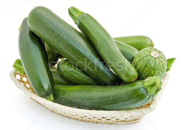 Fresh small green vegetable marrows in a wattled small basket Stock photo © vavlt