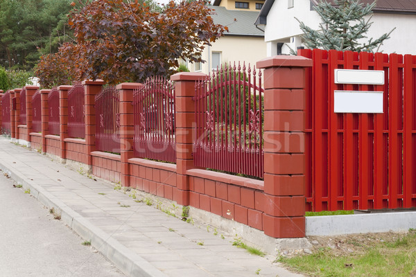 The red fence is located in rural street Stock photo © vavlt