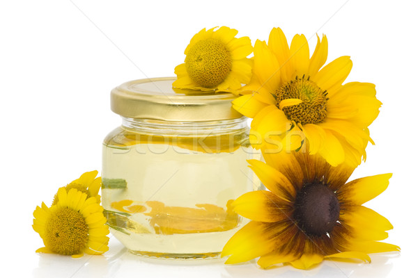 Cosmetic oil from yellow flowers Stock photo © vavlt