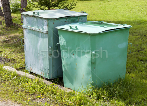 Old green garbage tanks Stock photo © vavlt