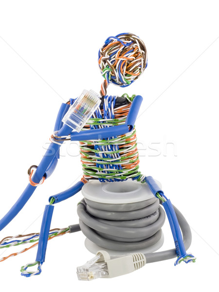 Twisted man looks on patch cable Stock photo © vavlt