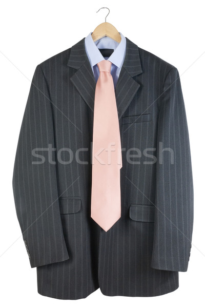The old striped  jacket and pink tie hang on a hanger Stock photo © vavlt