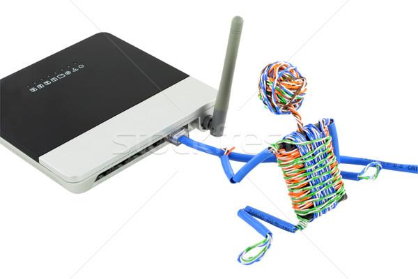 Człowiek bezprzewodowej router mały kabel komputerowy móc Zdjęcia stock © vavlt