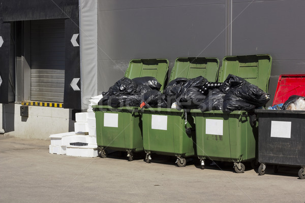 Green garbage containers  near large food shop Stock photo © vavlt