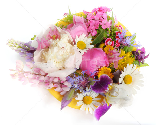Yellow plate with June flowers Stock photo © vavlt