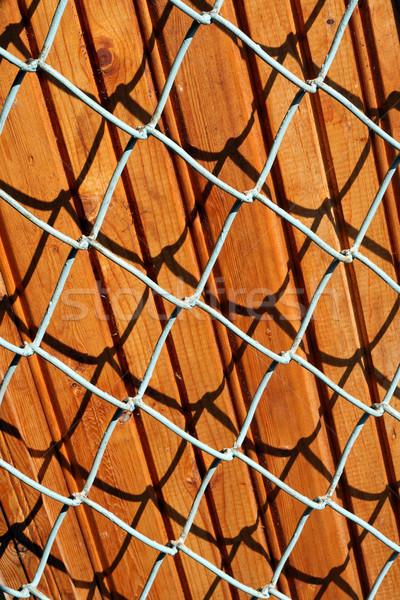 Wooden panels behind a lattice Stock photo © vavlt