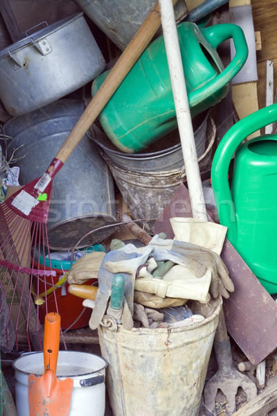 Stock photo: Dirty garden tools in a shed