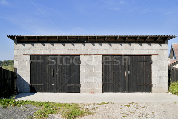 Rural garage blocs masse deux voitures Photo stock © vavlt