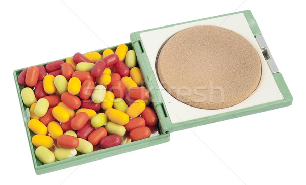 Multi-coloured tablets  pills  lie in a female powder box Stock photo © vavlt