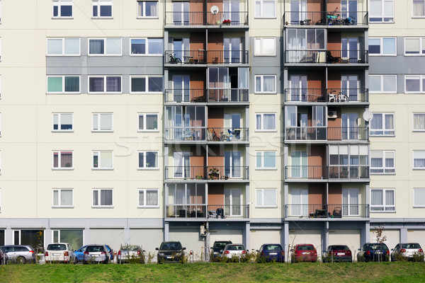 Windows, balconies, cars and lawn  of a multiroom apartment hous Stock photo © vavlt