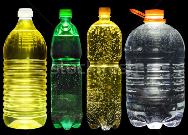 Limonade pétrolières eau plastique bouteilles Photo stock © vavlt