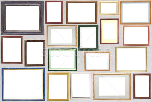 Various wooden photo frames  hang on a wall Stock photo © vavlt