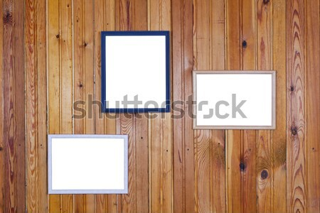 Pictures frames on pine wall Stock photo © vavlt