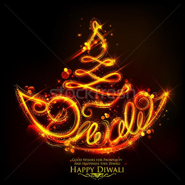 Stock photo: Burning diya on happy Diwali Holiday background for light festival of India