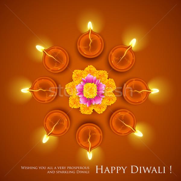 Decorated Diwali Diya on Flower Rangoli Stock photo © vectomart