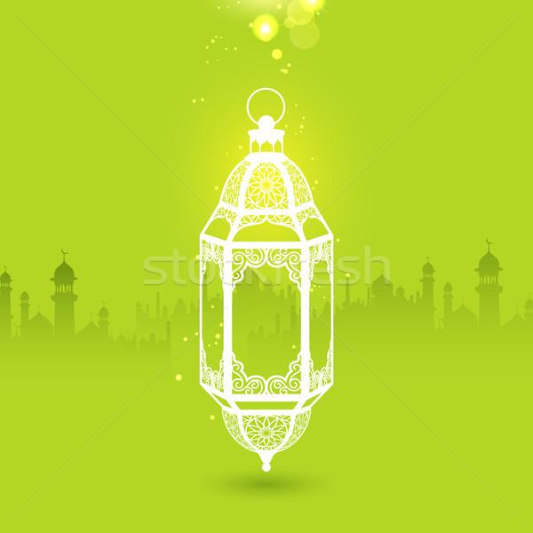 Ramadan Kareem (Generous Ramadan) greeting with illuminated lamp Stock photo © vectomart