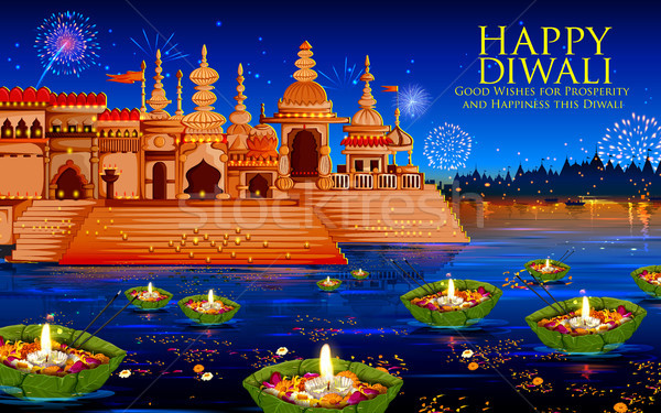 Floating diya in river on Happy Diwali Holiday background for light festival of India Stock photo © vectomart