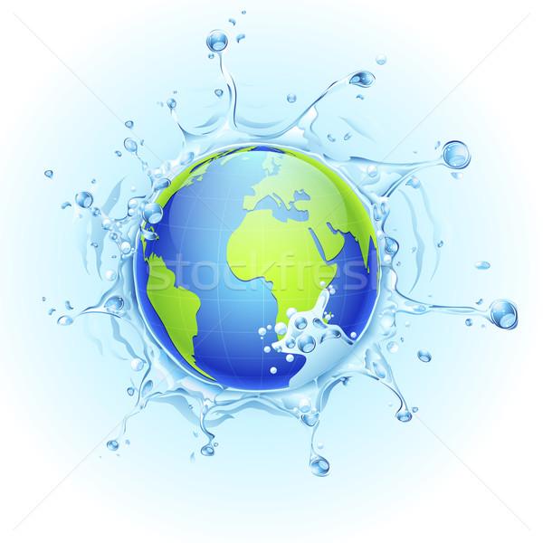 Earth in Splash of Water Stock photo © vectomart