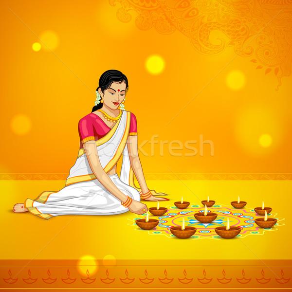 Woman burning diya for Indian festival Diwali Stock photo © vectomart