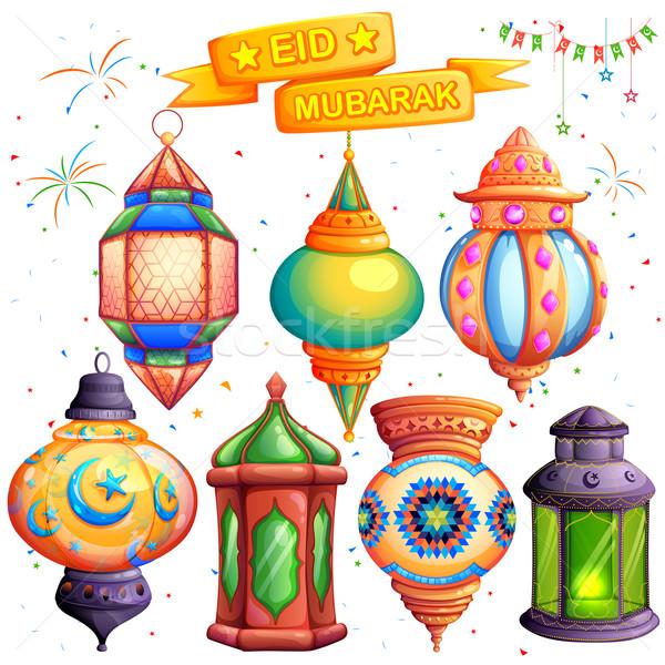 Eid Mubarak greeting with illuminated lamp Stock photo © vectomart