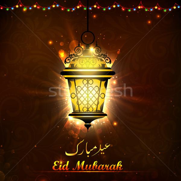 Illuminated lamp on Eid Mubarak background Stock photo © vectomart