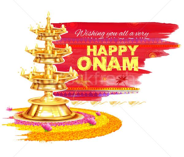 Happy Onam background with rangoli and lamp Stock photo © vectomart