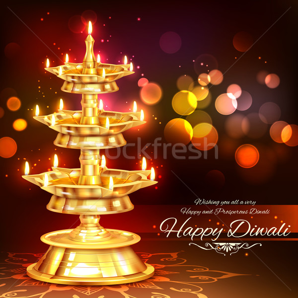 Stock photo: Golden diya stand on abstract Diwali background