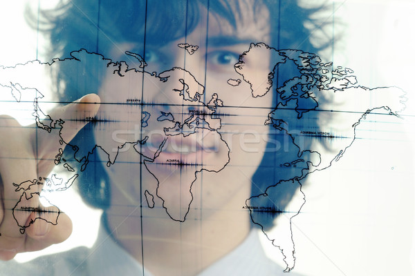 Man with map of the world Stock photo © velkol
