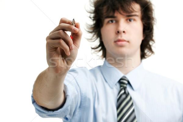 Gestionnaire jeunes écrit quelque chose air affaires Photo stock © velkol