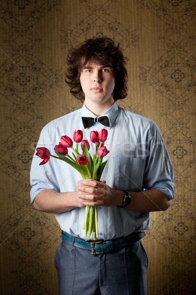 Sevmek görüntü yakışıklı adam kırmızı lale el Stok fotoğraf © velkol