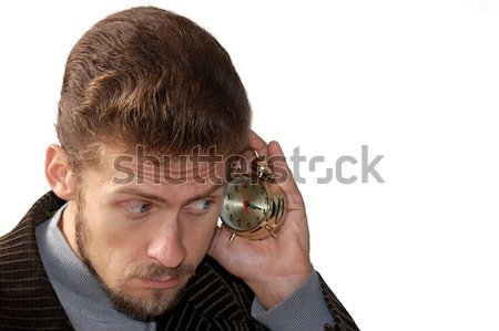 Man listening alarm clock Stock photo © velkol