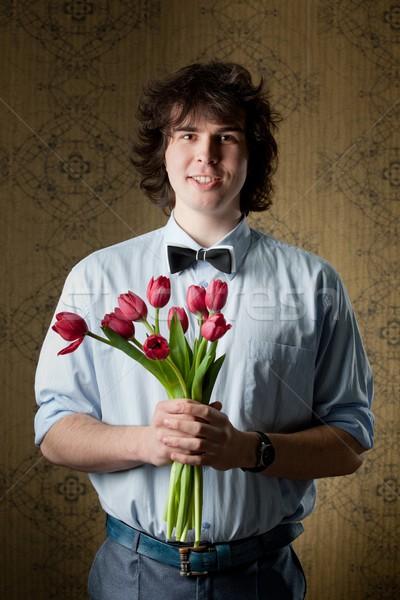 Amor imagem homem bonito vermelho tulipas mão Foto stock © velkol