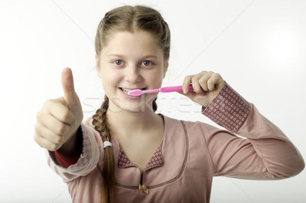 Aranyos lány fogmosás fehér izolált boldog Stock fotó © velkol