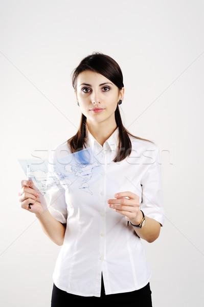 Girl with map Stock photo © velkol