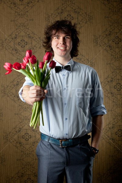 Image bel homme rouge tulipes main amour Photo stock © velkol