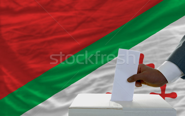man voting on elections in front of national flag of katanga Stock photo © vepar5